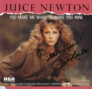 JUICE NEWTON - INSCRIBED ADVERTISEMENT SIGNED CIRCA 1985