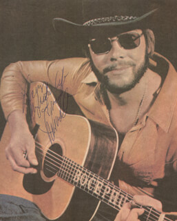 HANK WILLIAMS JR. - INSCRIBED MAGAZINE PHOTO SIGNED