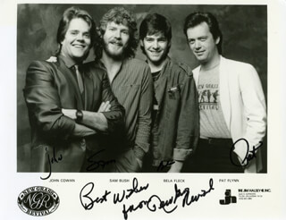 NEW GRASS REVIVAL - PRINTED PHOTOGRAPH SIGNED IN INK CO-SIGNED BY: NEW GRASS REVIVAL (JOHN COWAN), NEW GRASS REVIVAL (SAM BUSH), NEW GRASS REVIVAL (BELA FLECK), NEW GRASS REVIVAL (PAT FLYNN)