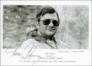 Autographs: TOM CLANCY - INSCRIBED PHOTOGRAPH SIGNED CIRCA 1984