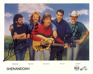 SHENANDOAH - PRINTED PHOTOGRAPH SIGNED IN INK CO-SIGNED BY: SHENANDOAH (JIM SEALES), SHENANDOAH (MARTY RAYBON), SHENANDOAH (RALPH EZELL), SHENANDOAH (STAN THORN), SHENANDOAH (MIKE MCGUIRE)
