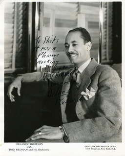 ORLANDO ROBERSON - INSCRIBED PRINTED PHOTOGRAPH SIGNED IN INK