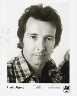 Autographs: HERB ALPERT - PRINTED PHOTOGRAPH SIGNED IN INK
