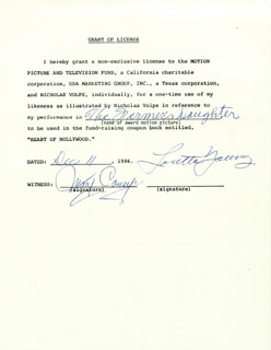 LORETTA YOUNG - PRINTED DOCUMENT SIGNED IN INK 12/11/1986