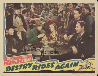 Autographs: DESTRY RIDES AGAIN MOVIE CAST - LOBBY CARD SIGNED CO-SIGNED BY: MARLENE DIETRICH, JAMES JIMMY STEWART