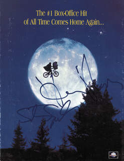 E.T., THE EXTRA-TERRESTRIAL - ADVERTISEMENT SIGNED CIRCA 1996 CO-SIGNED BY: STEVEN SPIELBERG, HENRY THOMAS