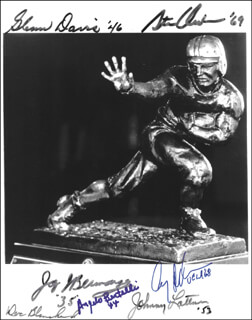HEISMAN TROPHY WINNERS - AUTOGRAPHED SIGNED PHOTOGRAPH CO-SIGNED BY: JOHNNY LATTNER, JAY BERWANGER, GLENN W. DAVIS, GARY J. BEBAN, DOC (FELIX ANTHONY) BLANCHARD, STEVE E. OWENS