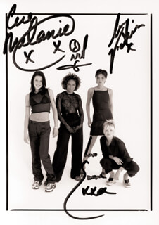 THE SPICE GIRLS - AUTOGRAPHED SIGNED PHOTOGRAPH CO-SIGNED BY: SPICE GIRLS (MELANIE JAYNE SPORTY SPICE CHISHOLM), SPICE GIRLS (MELANIE JANINE SCARY SPICE BROWN), SPICE GIRLS (VICTORIA POSH SPICE ADAMS BECKHAM), SPICE GIRLS (EMMA LEE BABY SPICE BUNTON)