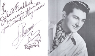 LIBERACE - AUTOGRAPHED INSCRIBED PHOTOGRAPH