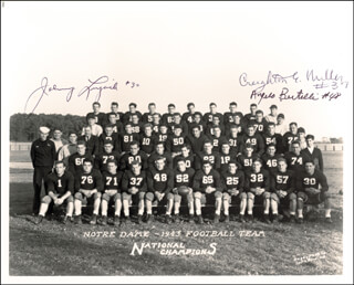 THE NOTRE DAME FOOTBALL TEAM - AUTOGRAPHED SIGNED PHOTOGRAPH CO-SIGNED BY: CREIGHTON MILLER, JOHNNY LUJACK, ANGELO B. ACCURATE ANGELO BERTELLI