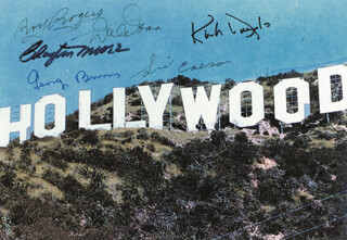 HOLLYWOOD STARS - AUTOGRAPHED SIGNED PHOTOGRAPH CO-SIGNED BY: CLAYTON THE LONE RANGER MOORE, GEORGE BURNS, DALE EVANS, SID CAESAR, ROY ROGERS, KIRK DOUGLAS