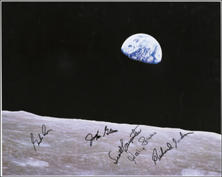 JOHN GLENN - AUTOGRAPHED SIGNED PHOTOGRAPH CO-SIGNED BY: COLONEL GORDON COOPER JR., CAPTAIN WALLY M. SCHIRRA, SCOTT CARPENTER, CAPTAIN RICHARD F. DICK GORDON JR.