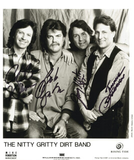 NITTY GRITTY DIRT BAND - PRINTED PHOTOGRAPH SIGNED IN INK 1997 CO-SIGNED BY: NITTY GRITTY DIRT BAND (JIMMIE FADDEN), NITTY GRITTY DIRT BAND (JEFF HANNA), NITTY GRITTY DIRT BAND (BOB CARPENTER), NITTY GRITTY DIRT BAND (JOHN McKUEN)