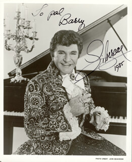 LIBERACE - AUTOGRAPHED INSCRIBED PHOTOGRAPH 1985