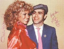 OLIVIA NEWTON-JOHN - AUTOGRAPHED SIGNED PHOTOGRAPH CO-SIGNED BY: SIR ELTON JOHN