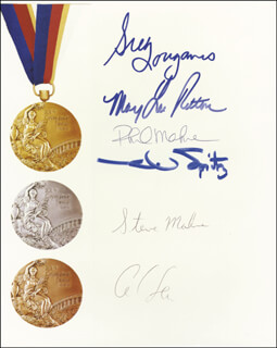 OLYMPIC MEDALISTS - AUTOGRAPHED SIGNED PHOTOGRAPH CO-SIGNED BY: MARY LOU RETTON, GREG LOUGANIS, CARL LEWIS, MARK SPITZ, STEVEN I. MAHRE, PHILLIP MAHRE