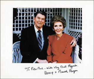 PRESIDENT RONALD REAGAN - INSCRIBED PHOTOGRAPH MOUNT SIGNED CO-SIGNED BY: FIRST LADY NANCY DAVIS REAGAN