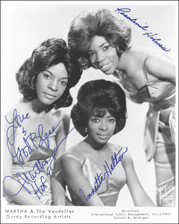 MARTHA REEVES & THE VANDELLAS - PRINTED PHOTOGRAPH SIGNED IN INK CO-SIGNED BY: MARTHA REEVES & THE VANDELLAS (MARTHA REEVES), MARTHA REEVES & THE VANDELLAS (ANNETTE BEARD), MARTHA REEVES & THE VANDELLAS (ROSALIND ASHFORD)