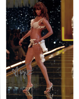 TYRA BANKS - AUTOGRAPHED SIGNED PHOTOGRAPH