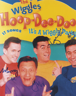 THE WIGGLES - AUTOGRAPHED SIGNED PHOTOGRAPH CO-SIGNED BY: THE WIGGLES (GREG PAGE), THE WIGGLES (MURRAY COOK), THE WIGGLES (JEFF FATT), THE WIGGLES (ANTHONY FIELD)