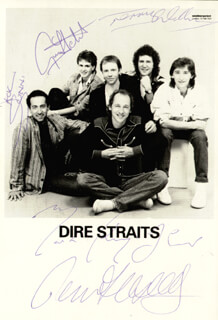DIRE STRAITS - AUTOGRAPHED SIGNED PHOTOGRAPH CO-SIGNED BY: DIRE STRAITS (MARK KNOPFLER), DIRE STRAITS (TERRY WILLIAMS), DIRE STRAITS (GUY FLETCHER), DIRE STRAITS (JOHN ILLSLEY)