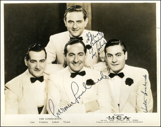 GUY LOMBARDO ORCHESTRA - AUTOGRAPHED INSCRIBED PHOTOGRAPH CIRCA 1936 CO-SIGNED BY: GUY LOMBARDO ORCHESTRA (CARMEN LOMBARDO), GUY LOMBARDO ORCHESTRA (GUY A. LOMBARDO), GUY LOMBARDO ORCHESTRA (VICTOR LOMBARDO)