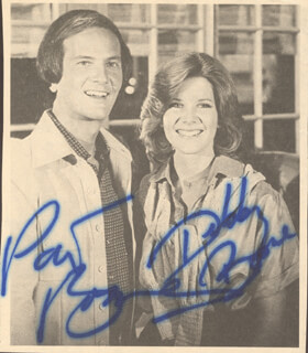 Autographs: PAT BOONE - NEWSPAPER PHOTOGRAPH SIGNED CO-SIGNED BY: DEBBY BOONE