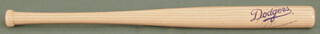 ERIC YOUNG - MINIATURE BASEBALL BAT SIGNED