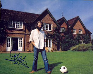 GENESIS (PHIL COLLINS) - AUTOGRAPHED SIGNED PHOTOGRAPH