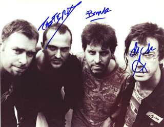 THE SUBHUMANS - AUTOGRAPHED SIGNED PHOTOGRAPH CO-SIGNED BY: THE SUBHUMANS (DICK LUCUS), THE SUBHUMANS (BRUCE TREASURE), THE SUBHUMANS (PHIL TROTSKY)
