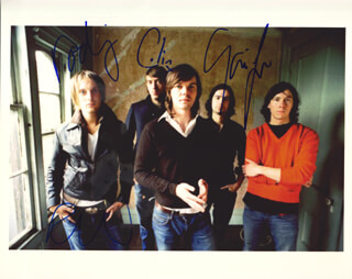 IDLEWILD - AUTOGRAPHED SIGNED PHOTOGRAPH CO-SIGNED BY: IDLEWILD (COLIN NEWTON), IDLEWILD (RODERICK WOOMBLE), IDLEWILD (GAVIN FOX), IDLEWILD (ROD JONES)