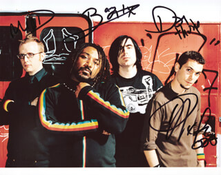 SKINDRED - AUTOGRAPHED SIGNED PHOTOGRAPH CO-SIGNED BY: SKINDRED (BENJI WEBBE), SKINDRED (MIKEY DEMUS), SKINDRED (DAN PUGSLEY), SKINDRED (ARYA GOGGIN)