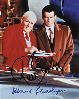 TOMORROW NEVER DIES MOVIE CAST - AUTOGRAPHED SIGNED PHOTOGRAPH CO-SIGNED BY: PIERCE BROSNAN, DESMOND LLEWELYN