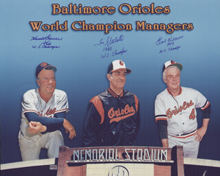 THE BALTIMORE ORIOLES - AUTOGRAPHED SIGNED PHOTOGRAPH CO-SIGNED BY: EARL WEAVER, HANK BAUER, JOE ALTOBELLI