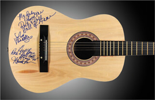 MARTHA REEVES & THE VANDELLAS (MARTHA REEVES) - GUITAR SIGNED CO-SIGNED BY: MARTHA REEVES & THE VANDELLAS (SANDRA (LOIS) REEVES)