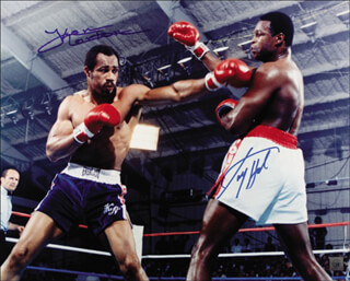 LARRY HOLMES - AUTOGRAPHED SIGNED PHOTOGRAPH CO-SIGNED BY: KEN NORTON