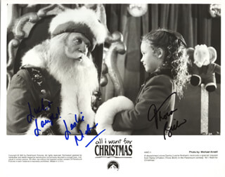 Autographs: ALL I WANT FOR CHRISTMAS MOVIE CAST - PHOTOGRAPH SIGNED CO-SIGNED BY: LESLIE NIELSEN, THORA BIRCH