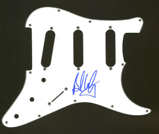 Autographs: AEROSMITH (BRAD WHITFORD) - PICK GUARD SIGNED