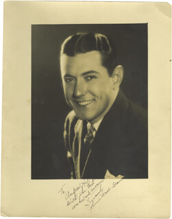 JOHNNY MACK BROWN - AUTOGRAPHED INSCRIBED PHOTOGRAPH