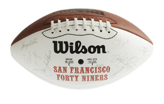 Autographs: THE SAN FRANCISCO FORTY NINERS - FOOTBALL SIGNED CO-SIGNED BY: JERRY RICE, ROGER T. CRAIG, JIM BURT, JOE MONTANA, STEVE YOUNG, RONNIE LOTT, CHUCK THOMAS, BARRY HELTON, JOHN TAYLOR, ERIC WRIGHT, JIM FAHNHORST, PIERCE HOLT, RICKY SIGLAR, RON LEWIS, CHET BROOKS, KEENA TURNER, MATT MILLEN, JAMIE WILLIAMS, WESLEY WALLS, STEVE BONO, JESSE SAPOLU, DAVID WAYMER, MIKE WILSON, BRENT JONES, DEXTER CARTER, GUY MCINTYRE, DARRYL POLLARD, SPENCER TILLMAN, BUBBA PARIS, BILL ROMANOWSKI, DENNIS BROWN, HARRY SIDNEY, CHARLES HALEY, STEVE WALLACE, JOHNNIE JACKSON, MIKE COFER, MICHAEL CARTER, MIKE SHERRARD, DON GRIFFIN, PETE KUGLER, KEVIN FAGAN, TOM RATHMAN, KEITH DeLONG, ERIC DAVIS, MIKE WALTER