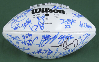 NEW YORK JETS - FOOTBALL SIGNED CO-SIGNED BY: CURTIS MARTIN, CHAD PENNINGTON, LAVERNUES COLES, ANTHONY CLEMENT, KERRY RHODES, JAMES DEARTH, JACOB BENDER, ANDRE DYSON, BRANDON MOORE, WAYNE CHREBET, KEVIN MAWAE, JOHN ABRAHAM, JONATHAN VILMA, QUINCY CARTER, SANTANA MOSS, ERIK COLEMAN, BROOKS BOLLINGER, GERALD SOWELL, JAY FIEDLER, JUSTIN MACAREINS, MIKE NUGENT, SHAUN ELLIS, ANTHONY BECHT