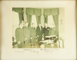 PRESIDENT JOHN F. KENNEDY - PHOTOGRAPH MOUNT SIGNED CIRCA 1961 CO-SIGNED BY: ADMIRAL ARLEIGH A. BURKE, GENERAL GEORGE H. DECKER, GENERAL LYMAN L. LEMNITZER, GENERAL THOMAS D. WHITE, GENERAL DAVID M. SHOUP