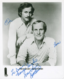THE SMOTHERS BROTHERS - INSCRIBED PRINTED PHOTOGRAPH SIGNED IN INK CO-SIGNED BY: SMOTHERS BROTHERS (DICK SMOTHERS), SMOTHERS BROTHERS (TOM SMOTHERS)