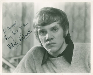 MALCOLM McDOWELL - AUTOGRAPHED INSCRIBED PHOTOGRAPH
