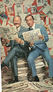 ROWAN & MARTIN - NEWSPAPER PHOTOGRAPH SIGNED CO-SIGNED BY: ROWAN & MARTIN (DICK MARTIN), ROWAN & MARTIN (DAN ROWAN)
