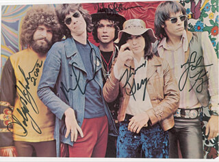 STEPPENWOLF - INSCRIBED MAGAZINE PHOTO SIGNED CO-SIGNED BY: STEPPENWOLF (JOHN KAY), STEPPENWOLF (GOLDY MC JOHN), STEPPENWOLF (NICK ST. NICHOLAS), STEPPENWOLF (MICHAEL MONARCH)