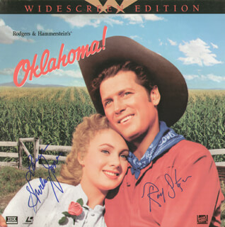 Autographs: OKLAHOMA! MOVIE CAST - LASER MEDIA COVER SIGNED CO-SIGNED BY: ROD STEIGER, SHIRLEY JONES