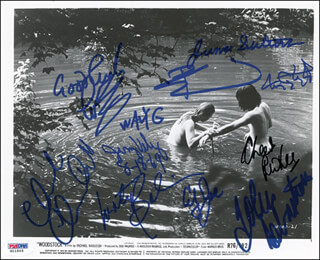 WOODSTOCK - AUTOGRAPHED SIGNED PHOTOGRAPH CO-SIGNED BY: THE WHO (PETER TOWNSHEND), LOVIN' SPOONFUL (JOHN SEBASTIAN), TEN YEARS AFTER (RIC LEE), TEN YEARS AFTER (LEO LYONS), TEN YEARS AFTER (CHICK CHURCHILL), JEFFERSON AIRPLANE (MARTY BALIN), GRATEFUL DEAD (TOM CONSTANTEN), WAVY GRAVY, COUNTRY JOE & THE FISH (JOE McDONALD), JUMA SULTAN, JERRY VELEZ