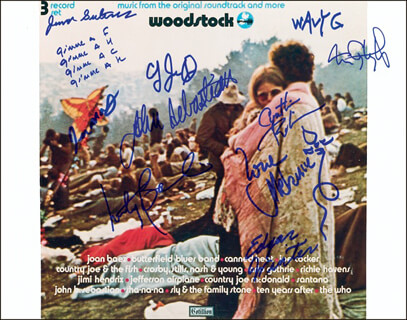 WOODSTOCK - AUTOGRAPHED SIGNED PHOTOGRAPH CO-SIGNED BY: LOVIN' SPOONFUL (JOHN SEBASTIAN), JEFFERSON AIRPLANE (MARTY BALIN), GRATEFUL DEAD (TOM CONSTANTEN), EDGAR WINTER, WAVY GRAVY, COUNTRY JOE & THE FISH (JOE McDONALD), SLY AND THE FAMILY STONE (CYNTHIA ROBINSON), SLY AND THE FAMILY STONE (JERRY MARTINI), JUMA SULTAN, MELANIE