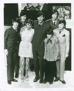 THE COWSILLS - AUTOGRAPHED INSCRIBED PHOTOGRAPH CO-SIGNED BY: THE COWSILLS (SUE COWSILL), THE COWSILLS (JOHN COWSILL), THE COWSILLS (BOB COWSILL), THE COWSILLS (BARRY COWSILL), THE COWSILLS (PAUL COWSILL)